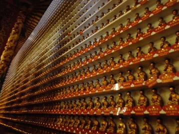 Literally 10,000 Buddha lined the walls, glowing and gleaming under the bright ceiling